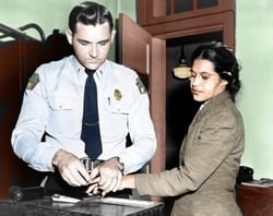 Rosa is being booked into jail (http://www.rosaparksfacts.com/rosa-parks-pictures-photos.php?type=civil-rights)