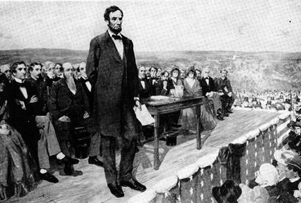 Abraham Lincoln speaking at Gettysburg, Pennsylva (http://grizzlymedia.files.wordpress.com/2007/11/gettysburg-address.jpg)
