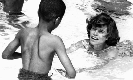 Shriver helping a child swim (http://static.guim.co.uk/sys-images/Guardian/Pix/pictures/2009/8/11/1250000914730/Eunice-Kennedy-Shriver-001.jpg)