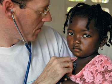Dr. Farmer cares for a young girl (http://www.bc.edu/bc_org/rvp/pubaf/chronicle/v13/a28/farmer.jpg)