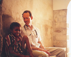 Dr. Farmer and a young girl (http://www.washington.edu/alumni/columns/sept06/images/stories/sep06_columns/word.jpg)
