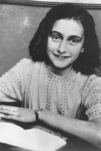Anne smiling happily  (http://www.holocaustresearchproject.org/nazioccupation/annefrank.html)