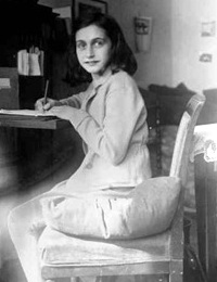 Anne doing what she loves writing (http://www.holocaustresearchproject.org/nazioccupation/annefrank.html)