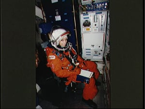 Ellen Ochoa in her space suit, inside a spaceship (NASA)