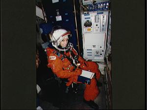 Ellen Ochoa in her space suit, inside a spaceship (NASA)