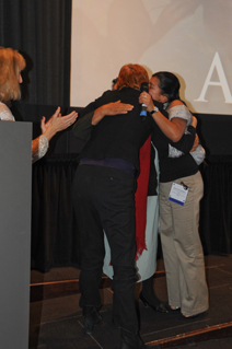 Erica Fernandez and her mom are embraced by Kathy Eldon at the 2011 MY HERO International Film Festival