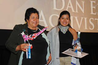 Erica Fernandez and her mom pose with their bird trophies at the 2011 MY HERO International Film Festival