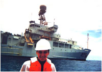 Courtney Schumacher taking sea surface measurements near the R/V Ronald H. Brown during the Tropical East Pacific Process Studies cruise in the tropical east Pacific Ocean, summer 1997. (Image courtesy of the University of Washington)