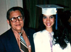 Rodriguez at her high school graduation with her father.
