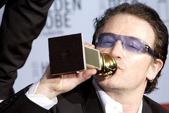Bono kissing his award won form the Golden Globes (http://nymag.com/daily/entertainment/2007/06/bono_would_call_this_appeals_cou.html)