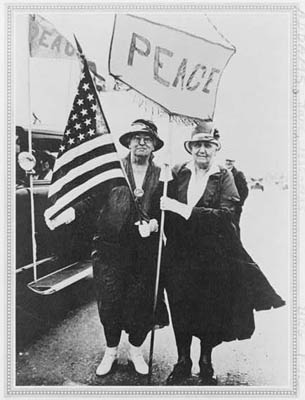 Jane Addams on the left holding the U.S. flag  (