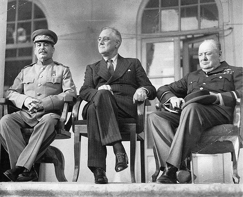 Roosevelt sitting with Churchill and Stalin