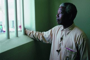 Nelson Mandela in his jail cell. (http://stevecotler.com/)