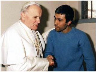 Pope John Paul II forgives his attempted killer. (http://resources2.news.com.au/)