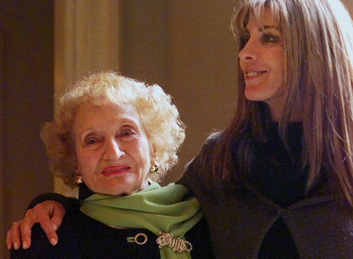 FILE- In this Jan. 9, 2001, file photo, Dr. Ruth Gruber, left, and actress Natasha Richardson pose for a photo at the Ritz Carlton Huntington Hotel in Pasadena, Calif. Gruber, the journalist and humanitarian whose long, trailblazing life included helping to bring Jewish refugees to the United States during World War II, has died. She was 105. Gruber died on Thursday, Nov. 17, 2016, at her home in Manhattan, according to her editor, Philip Turner. (AP Photo/Damian Dovarganes, File)