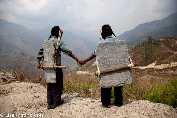 &quot;Brothers Carrying Stone, Nepal&quot; (Photo by <a href=https://www.lisakristine.com/lisa-kristine-receives-2013-lucie-humanitarian-award/>Lisa Kristine</a>)