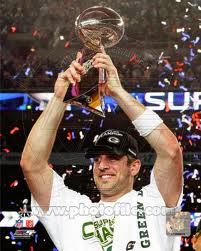 Aaron Rodgers holding the Super Bowl trophy (Google)