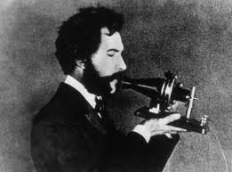 Bell speaking into his telephone (www.lazacode.com)
