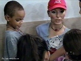 Shania Twain with the young children she seeks ou (https://www.shaniasplace.com)