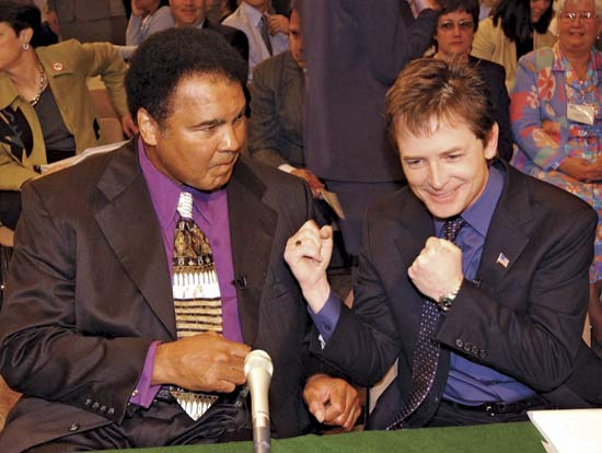 Michael J Fox (right) with Parkinson Patient Muha (http://positivelyparkinsons.blogspot.com/2010_11_01_archive.html)