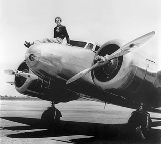 Amelia on her Biplane (http://www.fark.com/comments/3710525/On-this-date-in-1937-Amelia-Earhart-nears-completion-of-her-record-flight-arou)