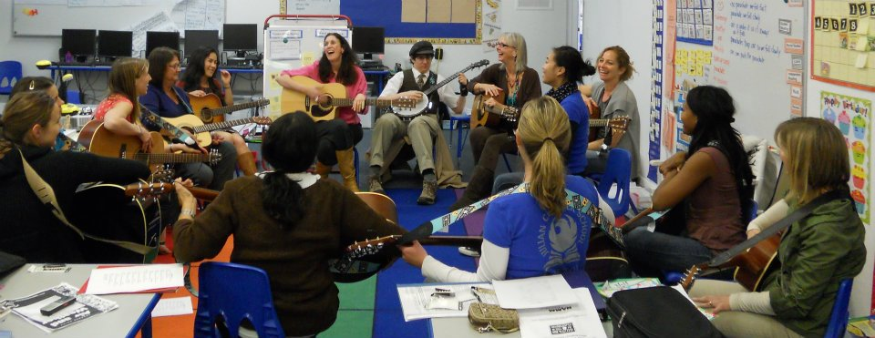 Jessica and her son, Elias Turner are jamming with a group of GITC classroom teachers. Elias is playing bango to her left (Jessica Baron)