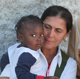 Robin with child in Haiti after the Earthquake. (Robin Lim ())