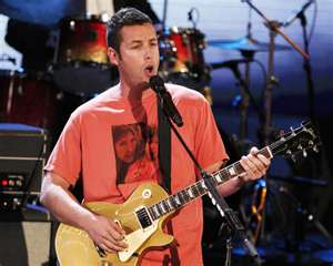 Sandler singing the Chanukha song
