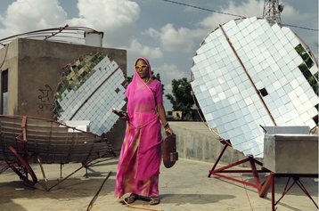 Solar-Engineer with parabolic solar cookers (http://www.wired.co.uk/magazine/archive/2011/04/features/disrupting-poverty?page=all ())