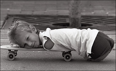 Nick at a young age, resting on a skateboard (thesun.co.uk)