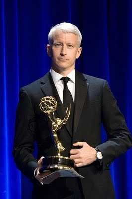 Anderson Cooper winning an Emmy in 2006 (http://thoroughlyandersoncooper.blogspot.com/2009/09/2009-emmys.html)