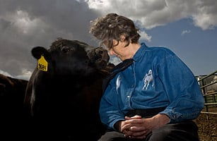 Temple Grandin with a cow (http://www.time.com/time/specials/packages/article/0,28804,1984685_1984949_1985222,00.html (Matt Slaby / Luceo for TIME))