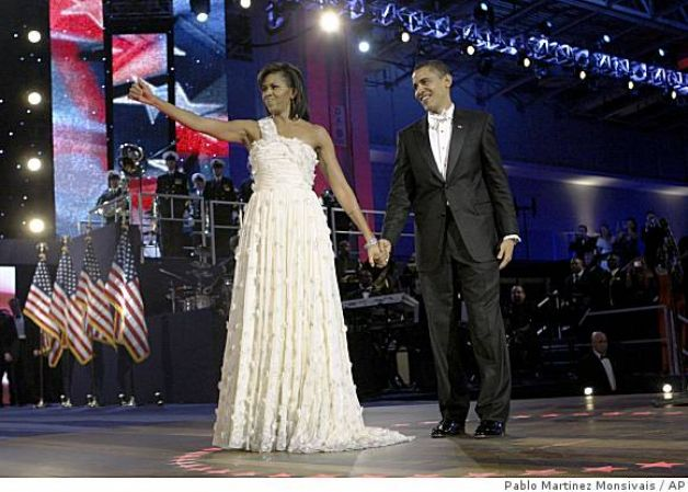 The 44th president and first lady  (http://www.sfgate.com/news/article/Michelle-Obama-surprises-with-designer-choices-3175654.php#photo-2031913 ())