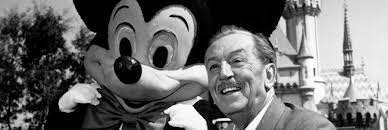 Walt Disney standing with Mickey Mouse in Disney. (Google ())