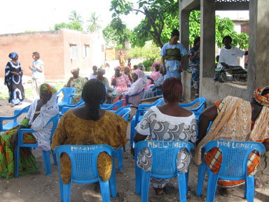 Nicole at a community meeting about the project<br>(Courtesy of Cheikh Seck)