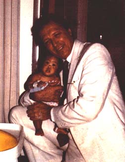 Dr. Kopits and one of his young patients<br> (http://www.hispraise.com/joanna/joanna.htm  )