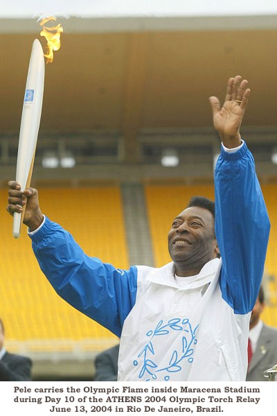 Pele carrying the Olympic Torch (360Soccer)