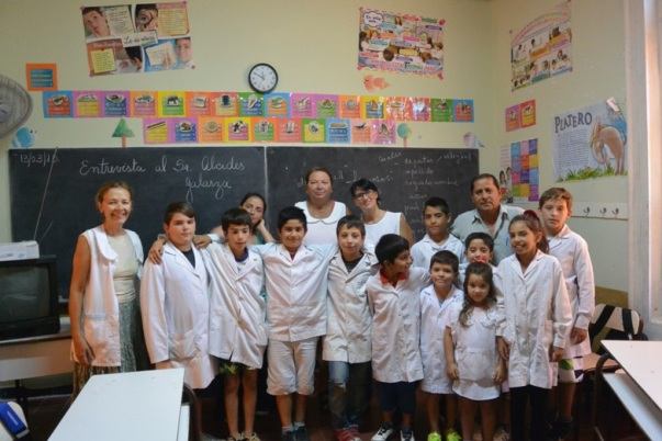 Students and staff of Isla Martín García with Anusia on the left, principalRosana Paoletta in the center and community hero,Alcidez Galarza on the right (Photo by Annie Merkley)