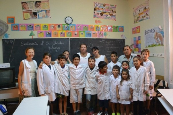 Students and staff of Isla Martín García with Anusia on the left, principal Rosana Paoletta in the center and community hero, Alcidez Galarza on the right (Photo by Annie Merkley)