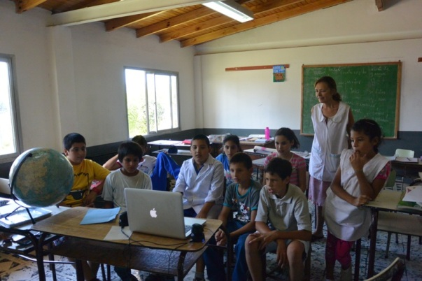 Anusia with students watching Biblioburro short documentary from The MY HERO Project (Photo by Annie Merkley)
