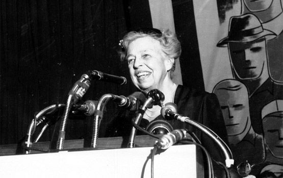 Eleanor speaking at a podium at an AFL-CIO event (http://www.yesmagazine.org (Peter Dreier))