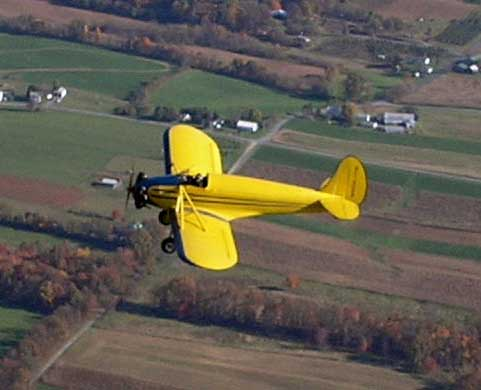 This is a yellow kinner airster biplane. (http://www.amazingaircraft.com/ ())