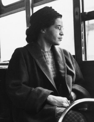 Rosa Parks staring out of a bus window (deepsouthmag.com ())