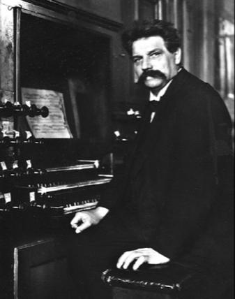 Albert Schweitzer sitting front of organ (www.ahlborn-galanti.com ())