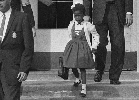 Ruby Bridges at her all-white school in 1960. (http://www.scholastic.com/teachers/sites/default/f (This was taken by a photographer in 1960.))
