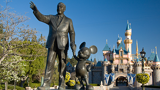A statue at Disneyland dedicated to Walt & Mickey