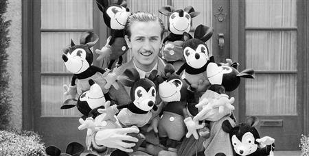 Walt is standing with Mickey Mouse, his creation. (https://d23.com/about-walt-disney/ ())