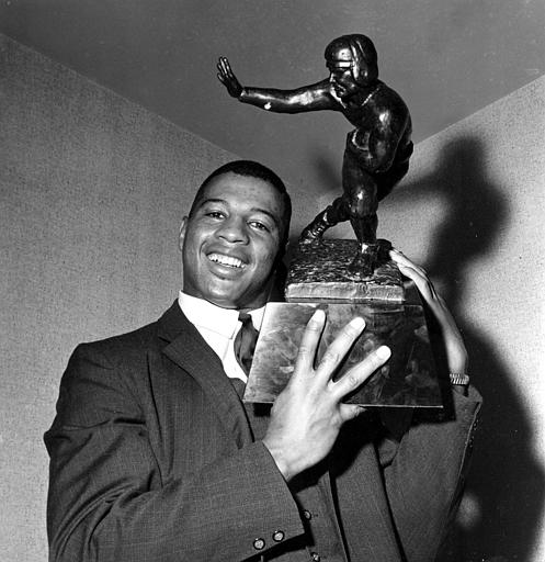 Ernie Davis holding his Heisman Trophy (https://uk.pinterest.com/pin/459156124483711292/ (Unknown))
