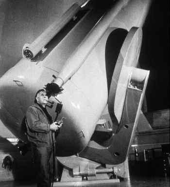 Edwin Hubble studying the stars ( (http://www.space.com/15665-edwin-powell-hubble.html))