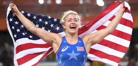 Helen celebrates her win by raising the flag  (Sports illustrated  ())